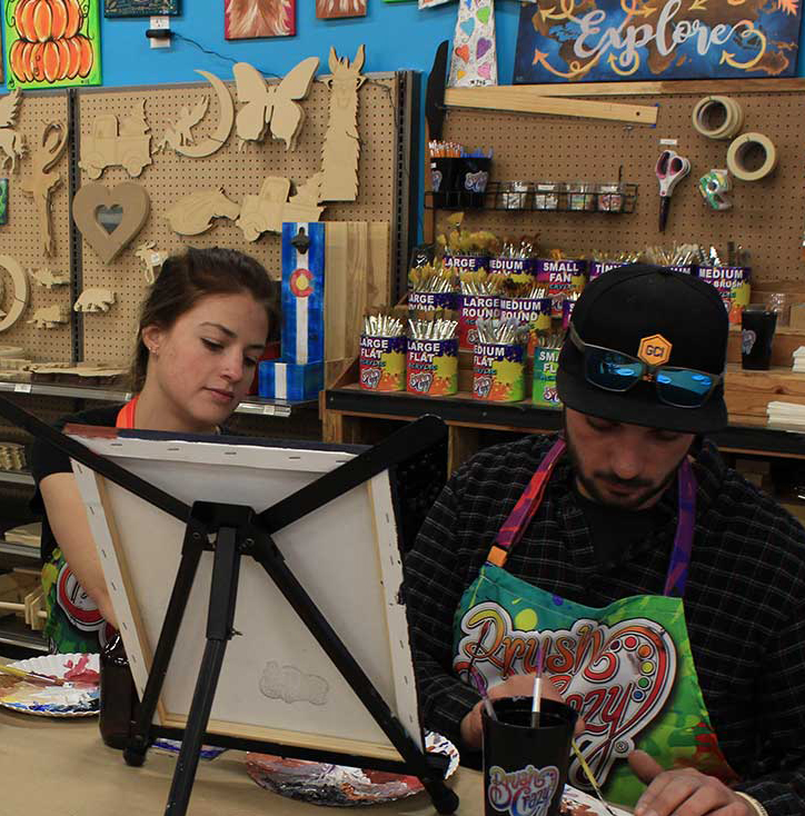 Couple on Date Night Painting a Canvas